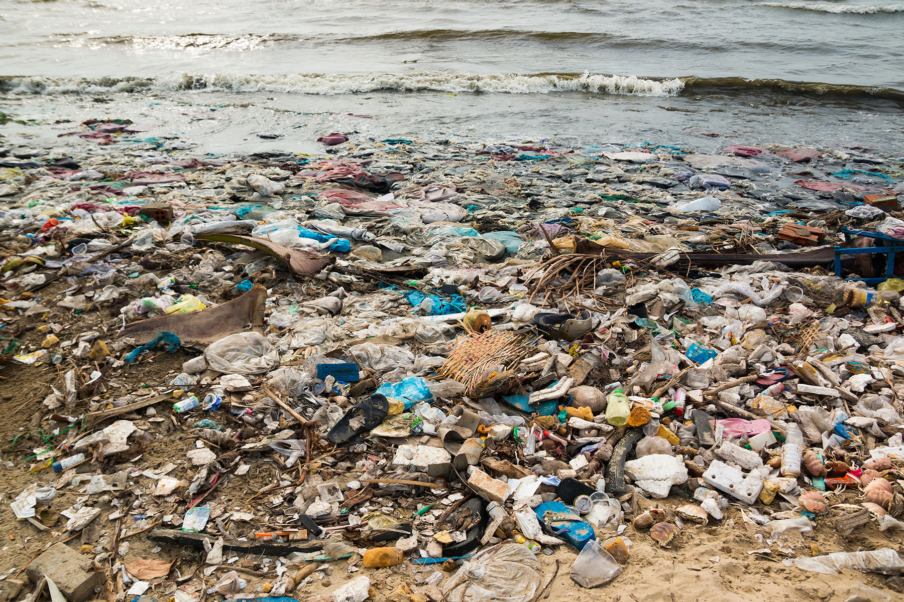 Polluted beach in fishing village, environment, pollution