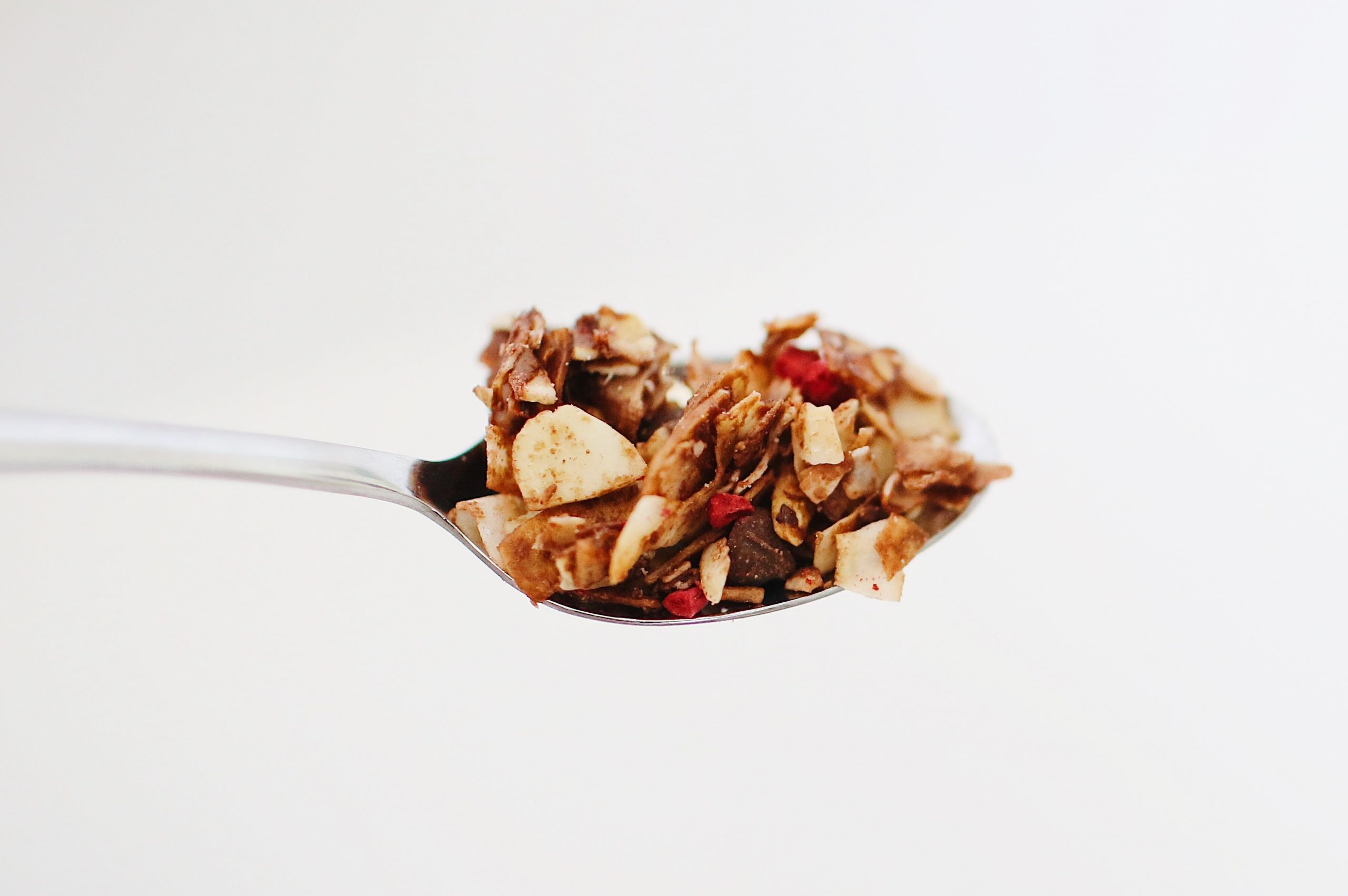 sugar free granola on a spoon